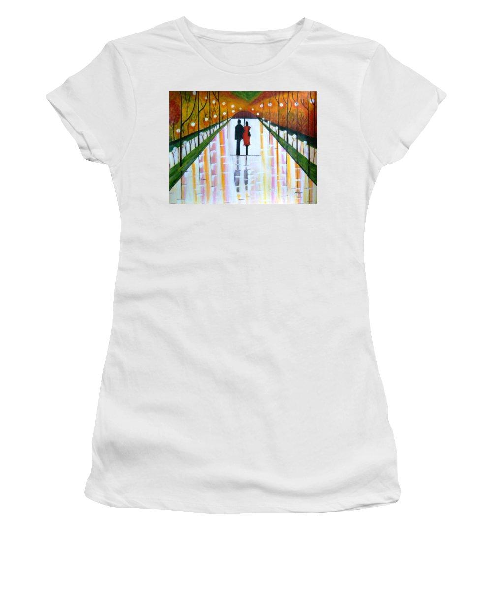 Romantic Painting Figures Romance Umbrella Rain Green Red Orange Grass People Lights Park Garden Tree Reflection Path Valentine Love Women's T-Shirt featuring the painting A Rainy Dayii by Manjiri Kanvinde