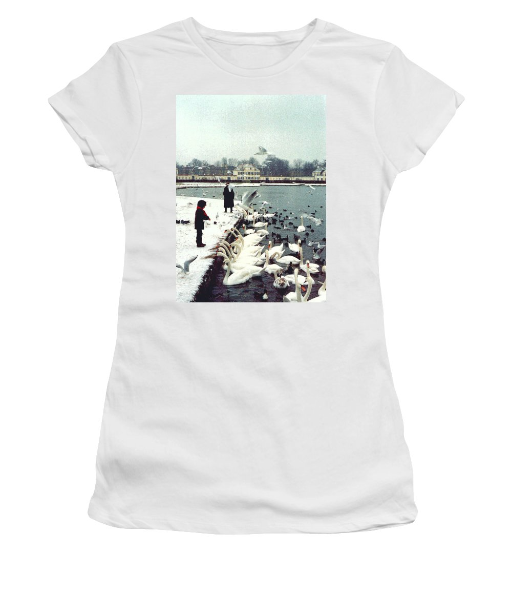 Swans Women's T-Shirt (Athletic Fit) featuring the photograph Boy Feeding Swans- Germany by Nancy Mueller