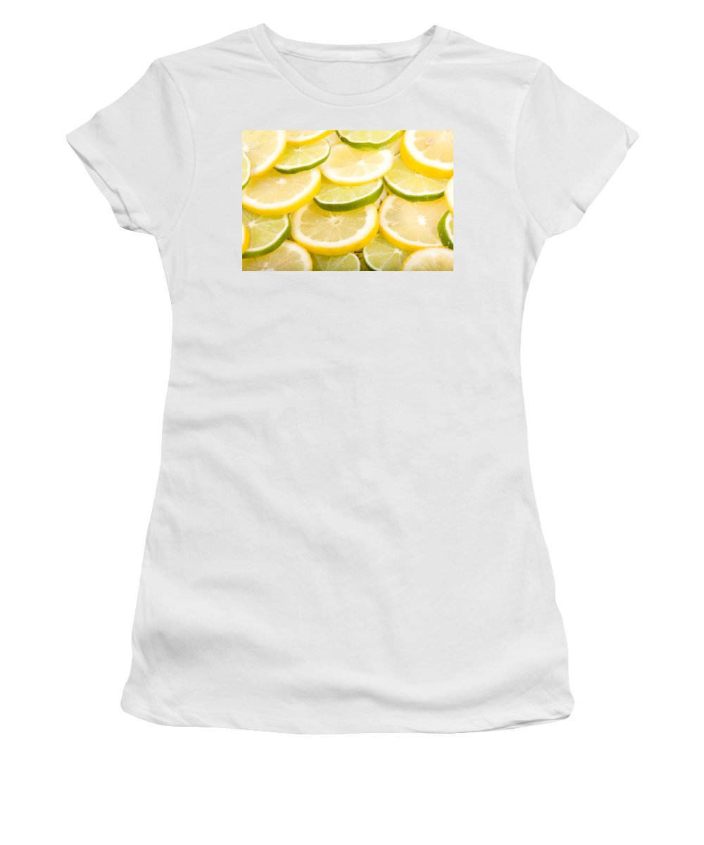 Lemons; Citrus; Citrus Fruit; Citrus Fruits; Close Up; Cross Section; Culinary; Food; Fruit; Fruits; Green; Key Lime; Key Limes; Lime; Limes; Slice; Sliced; Slices; Group; Sour Women's T-Shirt (Athletic Fit) featuring the photograph Lemons And Limes by James BO Insogna