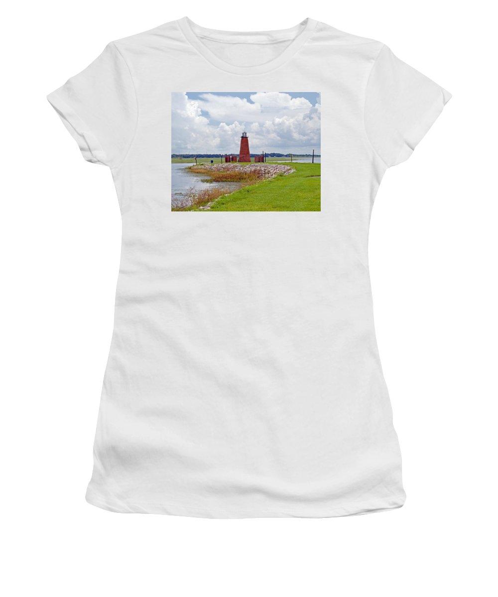 Florida; Kissimmee; Toho; Tohopekaliga; Port; Light; Lighthouse; House; Beacon; Brick; Central; Harb Women's T-Shirt featuring the photograph Lighthouse At Port Kissimmee On Lake Tohopekaliga In Central Florida  by Allan Hughes