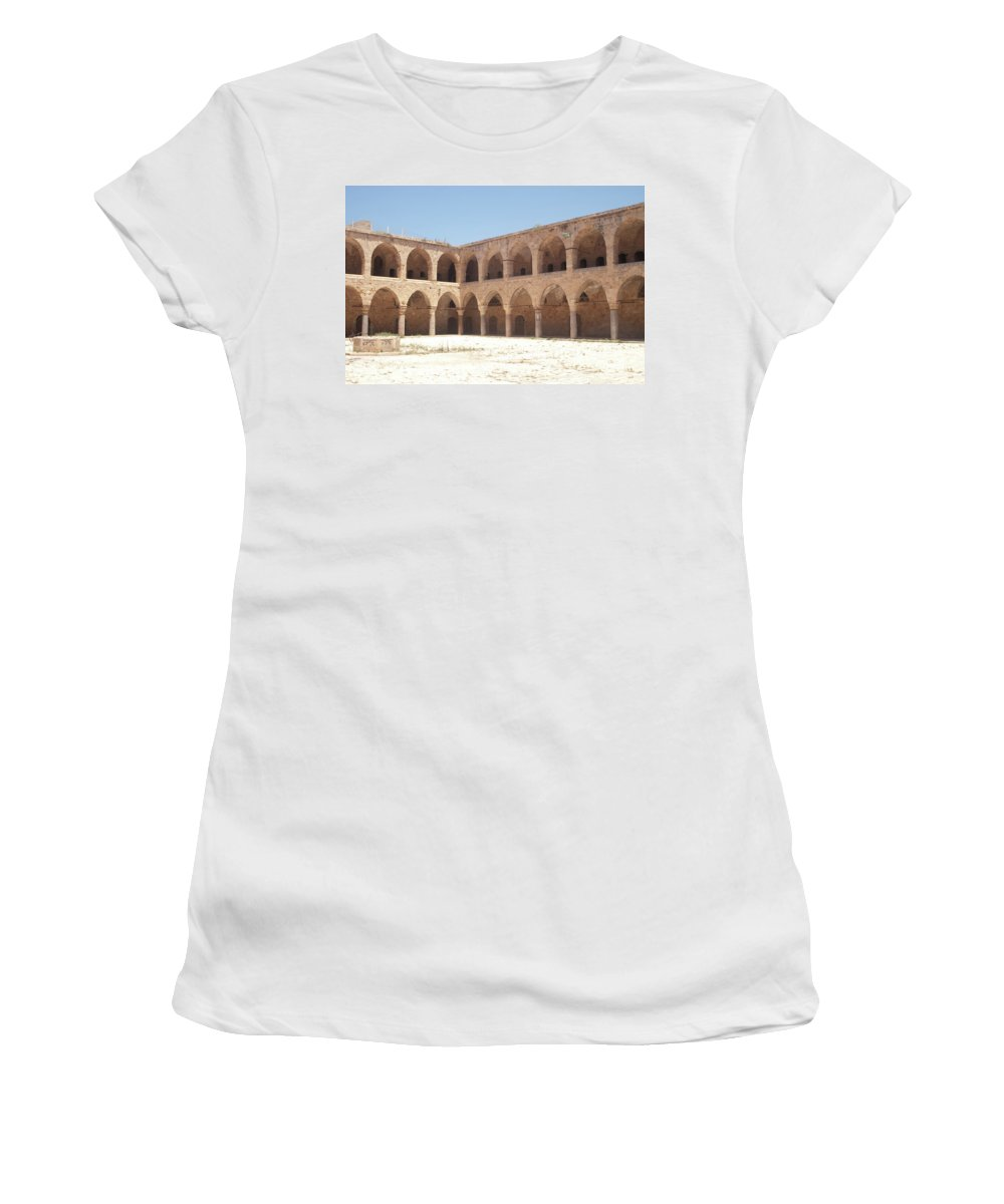 Khan Women's T-Shirt (Athletic Fit) featuring the photograph The Khan, Also Known As A Caravanserai, In Akko, Israel by Adam Gladstone