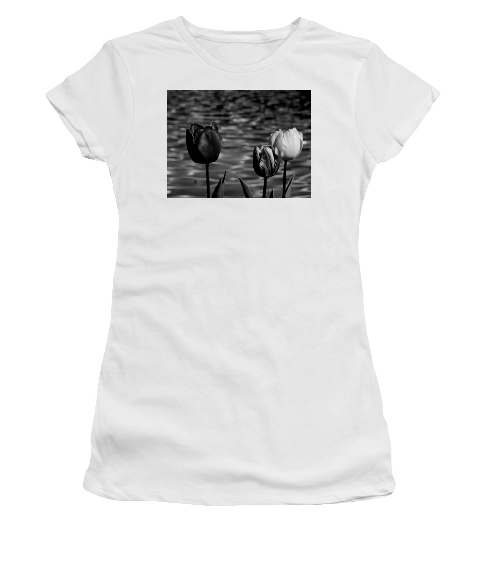 Tulips At Water Women's T-Shirt (Athletic Fit) featuring the photograph Tulips In Black And White by Yuri Tomashevi