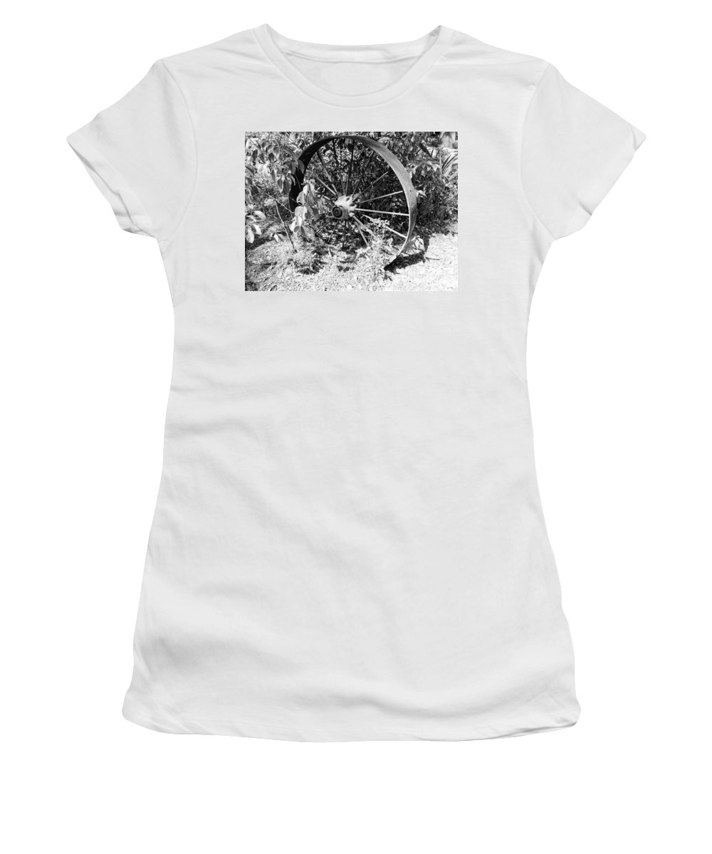 Wheel Women's T-Shirt featuring the photograph Wagon Wheel In B W by D Hackett
