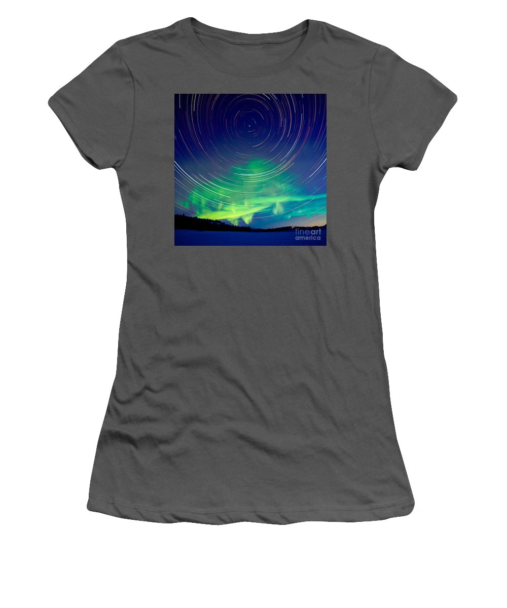 Astrophoto Women's T-Shirt (Athletic Fit) featuring the photograph Star Trails And Northern Lights In Night Sky by Stephan Pietzko