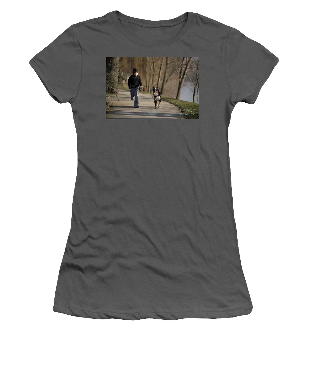 Bernese Mountain Dog Women's T-Shirt (Athletic Fit) featuring the photograph Boy Running With Dog by Jean-Michel Labat