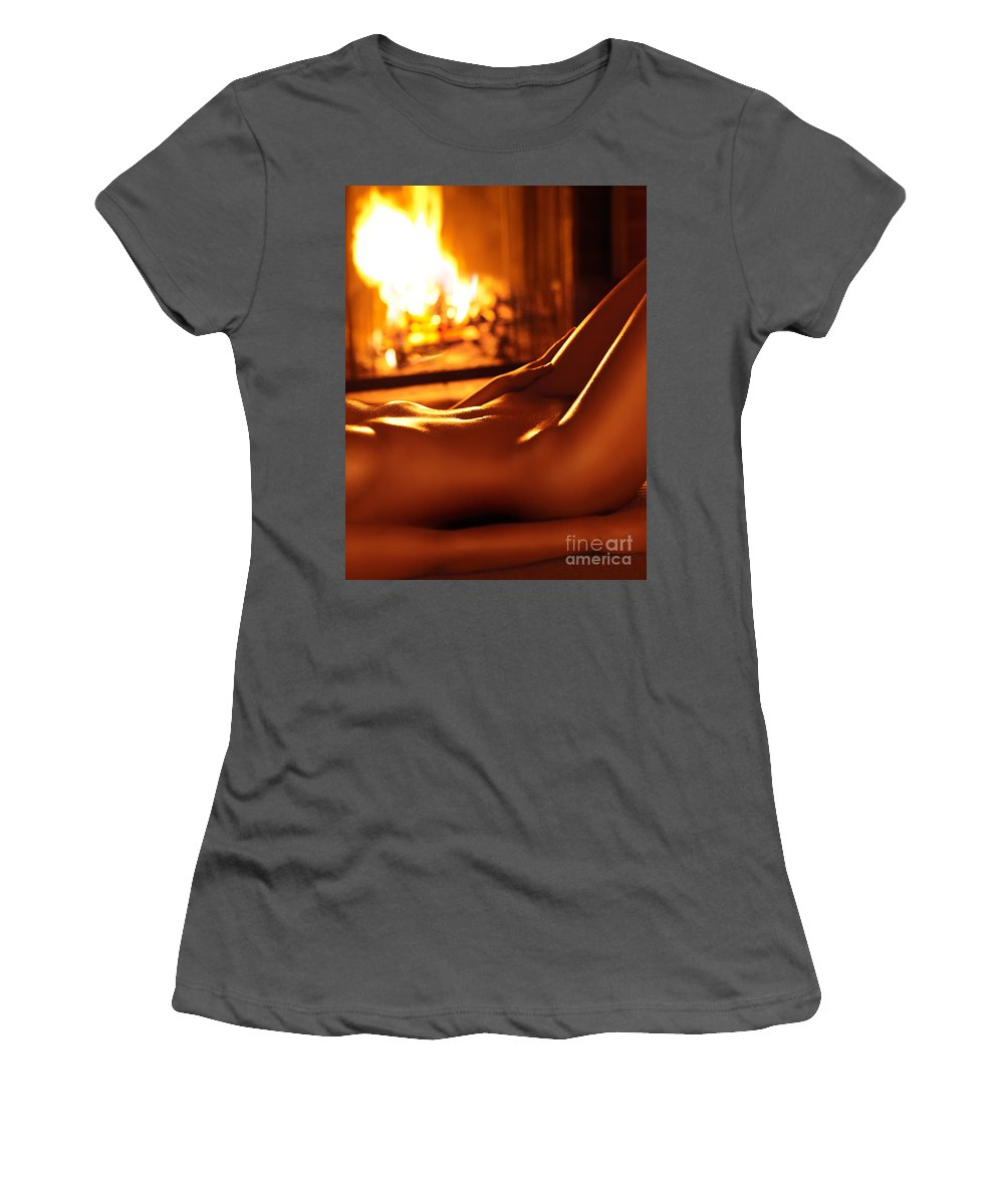 Nude Women's T-Shirt (Athletic Fit) featuring the photograph Nude Shiny Woman Body In Front Of Fireplace by Oleksiy Maksymenko