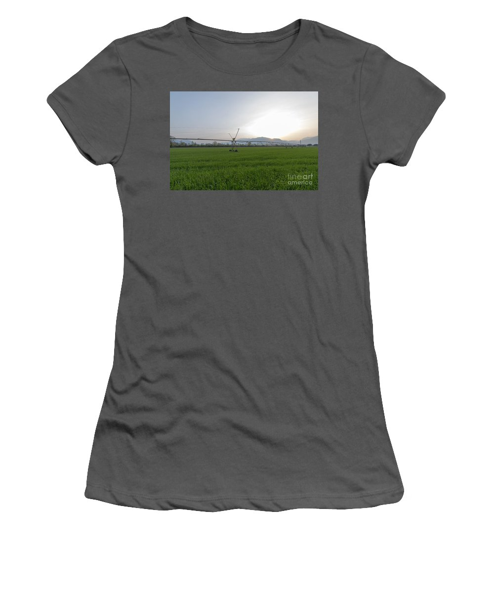 Sprinklers Women's T-Shirt (Athletic Fit) featuring the photograph Sprinklers On A Green Field by Mats Silvan