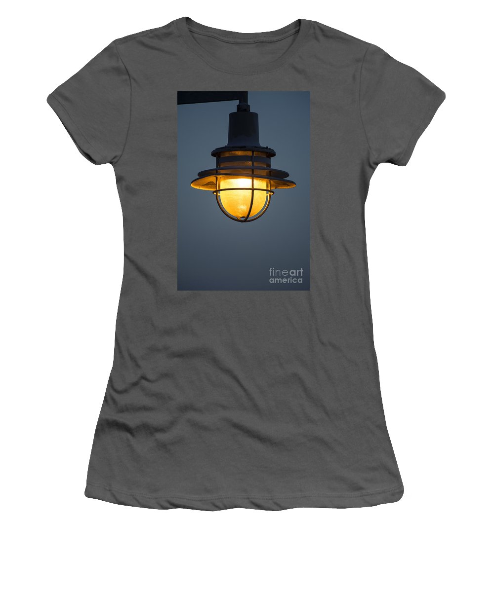 Amber Women's T-Shirt (Athletic Fit) featuring the photograph Street Lamp by John Greim