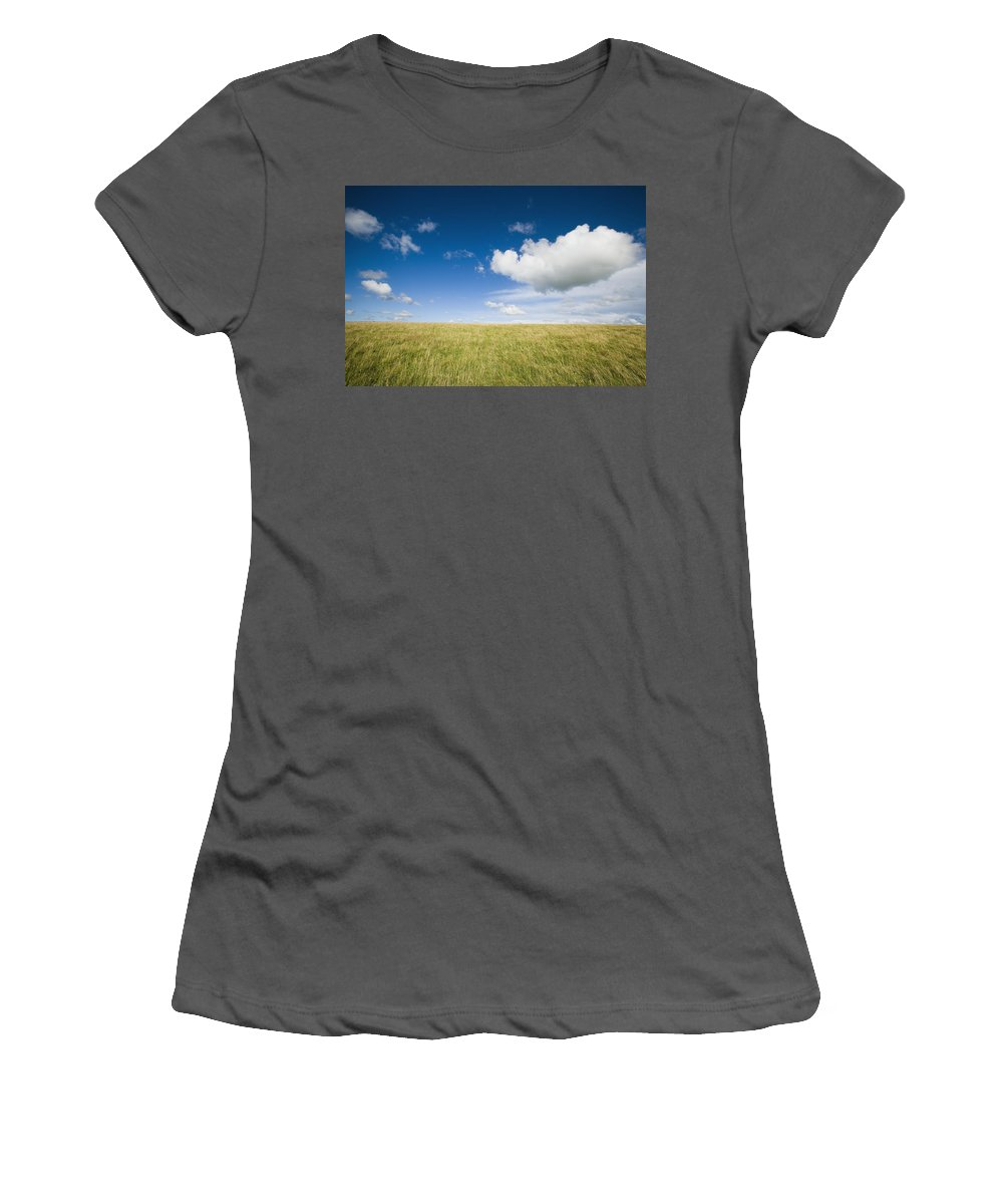 Photography Women's T-Shirt (Athletic Fit) featuring the photograph Grassy Field On Hill With Blue Skies by Axiom Photographic