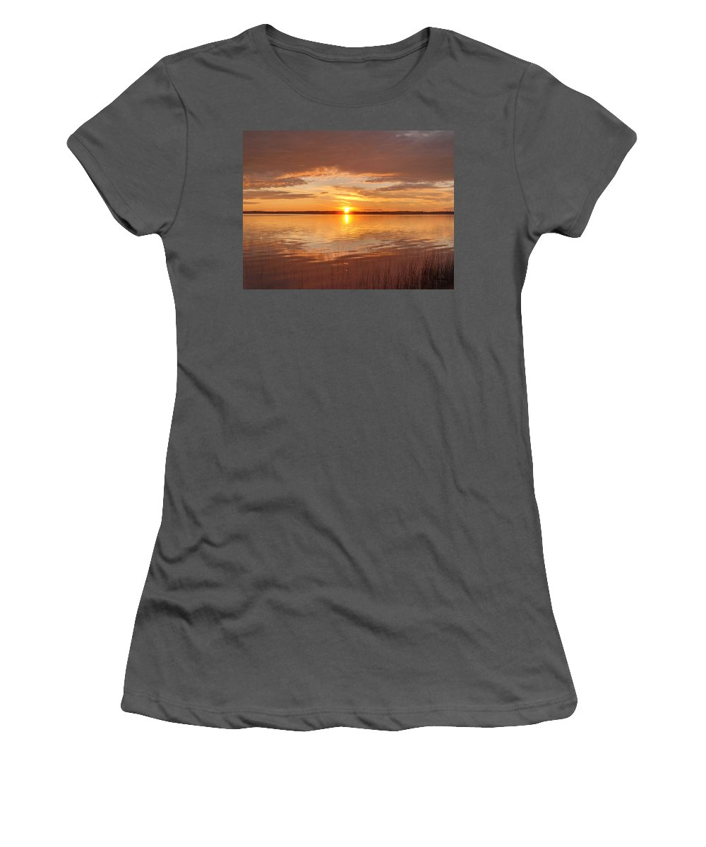 Lake Water Shore Reeds Beach Sunset Sky Women's T-Shirt (Athletic Fit) featuring the photograph Sunset by Andrea Lawrence