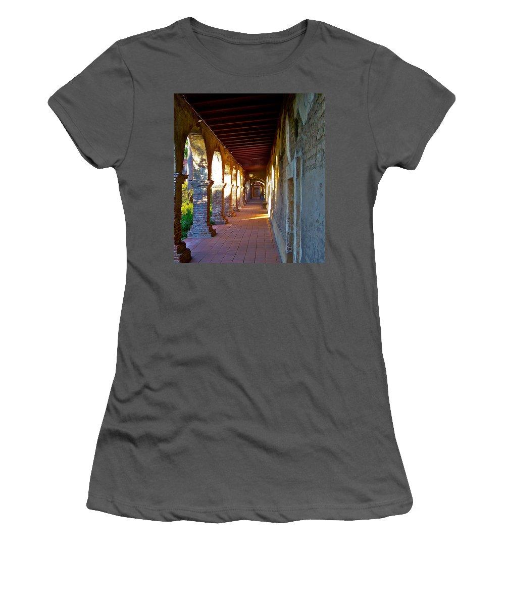 Corridor Women's T-Shirt (Athletic Fit) featuring the photograph The Corridor By The Serra Chapel San Juan Capistrano Mission California by Karon Melillo DeVega