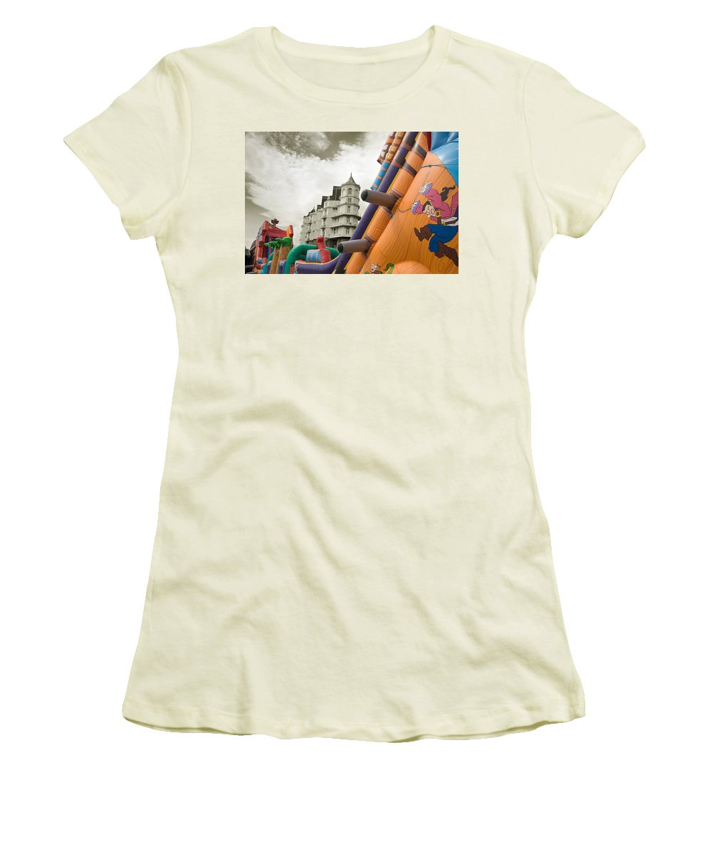 Childrens Women's T-Shirt (Athletic Fit) featuring the photograph Childrens Play Areas Contrast With The Victorian Elegance Of The Grand Hotel In Llandudno Wales Uk by Mal Bray