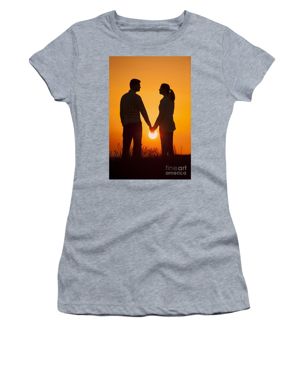 Couple Women's T-Shirt featuring the photograph Lovers Holding Hands At Sunset In Silhouette by Lee Avison