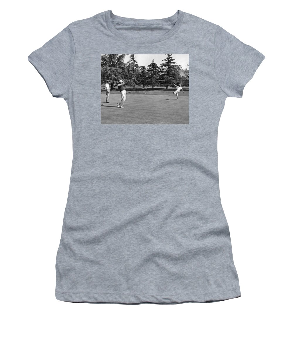 1950s Women's T-Shirt featuring the photograph Two Golfers Body English by Underwood Archives