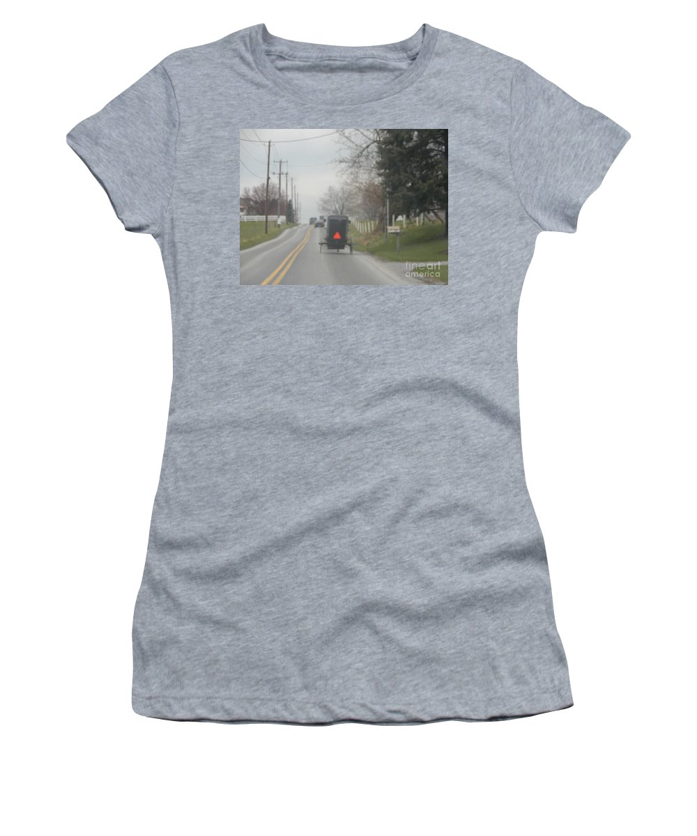Amish Women's T-Shirt featuring the photograph A Buggy Travels Down A Road In Spring by Christine Clark