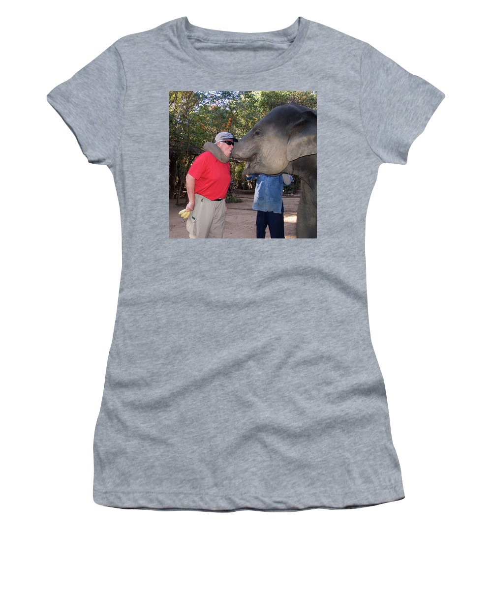 Man Holding Bananas Women's T-Shirt featuring the photograph Elephant Kissing Man Holding Bananas by Sally Weigand