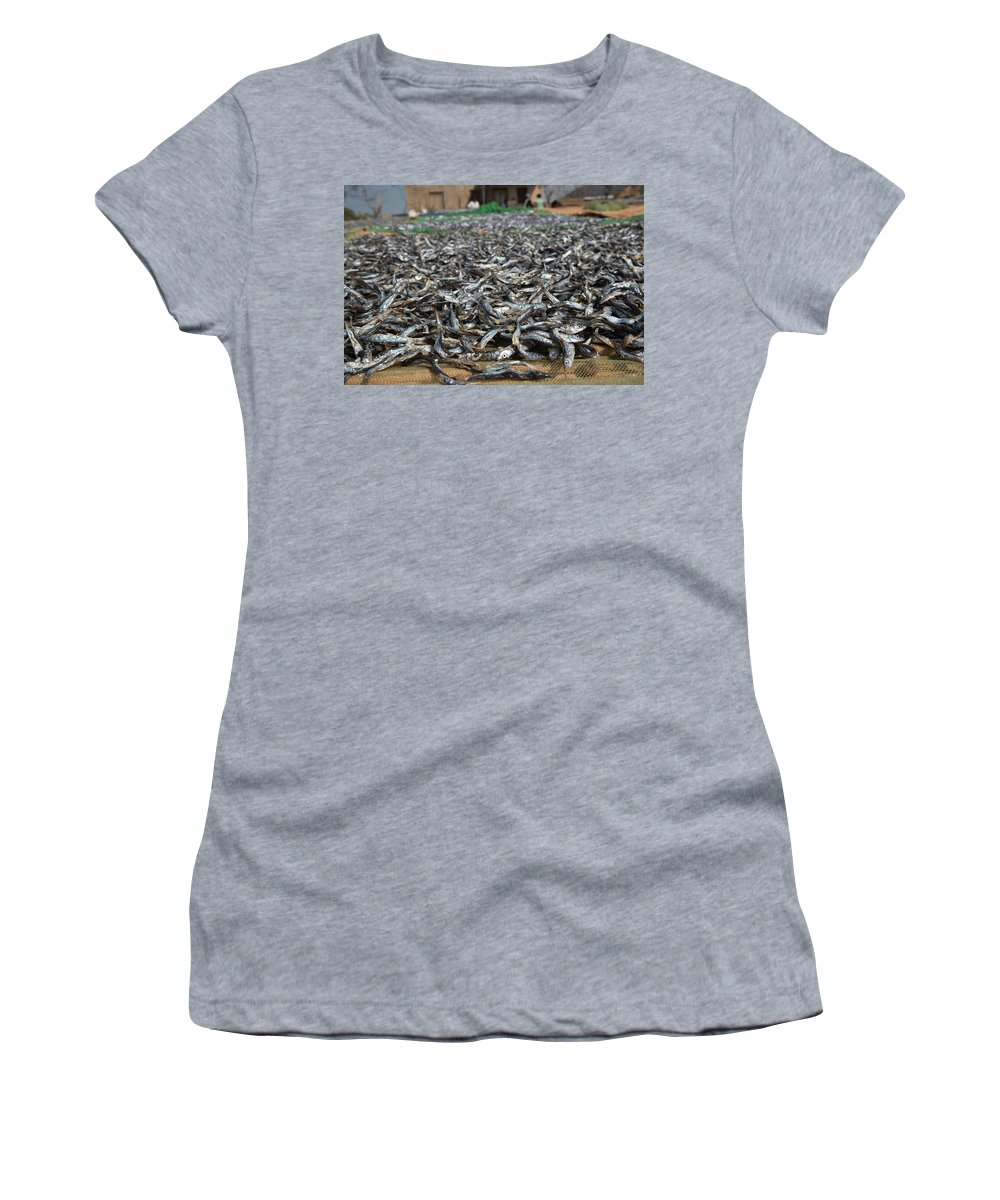 Fish Women's T-Shirt (Athletic Fit) featuring the photograph Kapenta Being Dried On The Beach - Lake Malawi by Gareth Pickering
