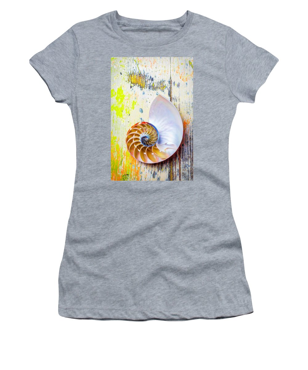 Chambered Nautilus Women's T-Shirt featuring the photograph Nautilus Shell On Old Board by Garry Gay