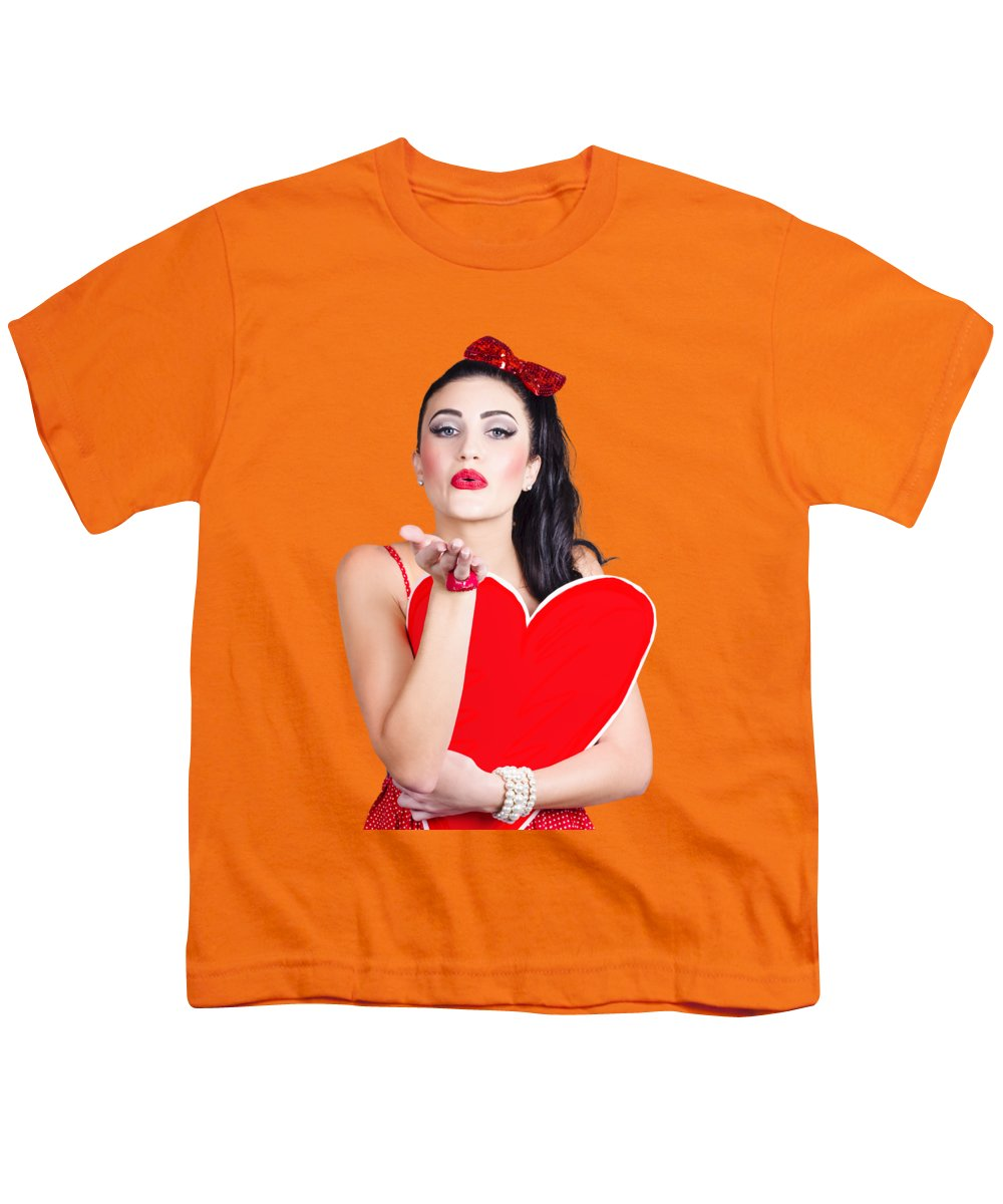 Heart Youth T-Shirt featuring the photograph Isolated Pin Up Woman Holding A Heart Shaped Sign by Jorgo Photography - Wall Art Gallery