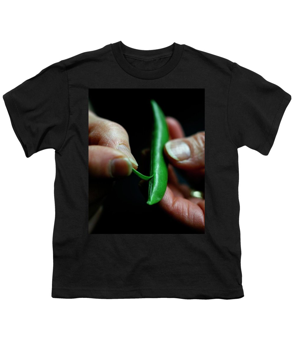 Fruits Youth T-Shirt featuring the photograph A Person Peeling A Bean by Romulo Yanes