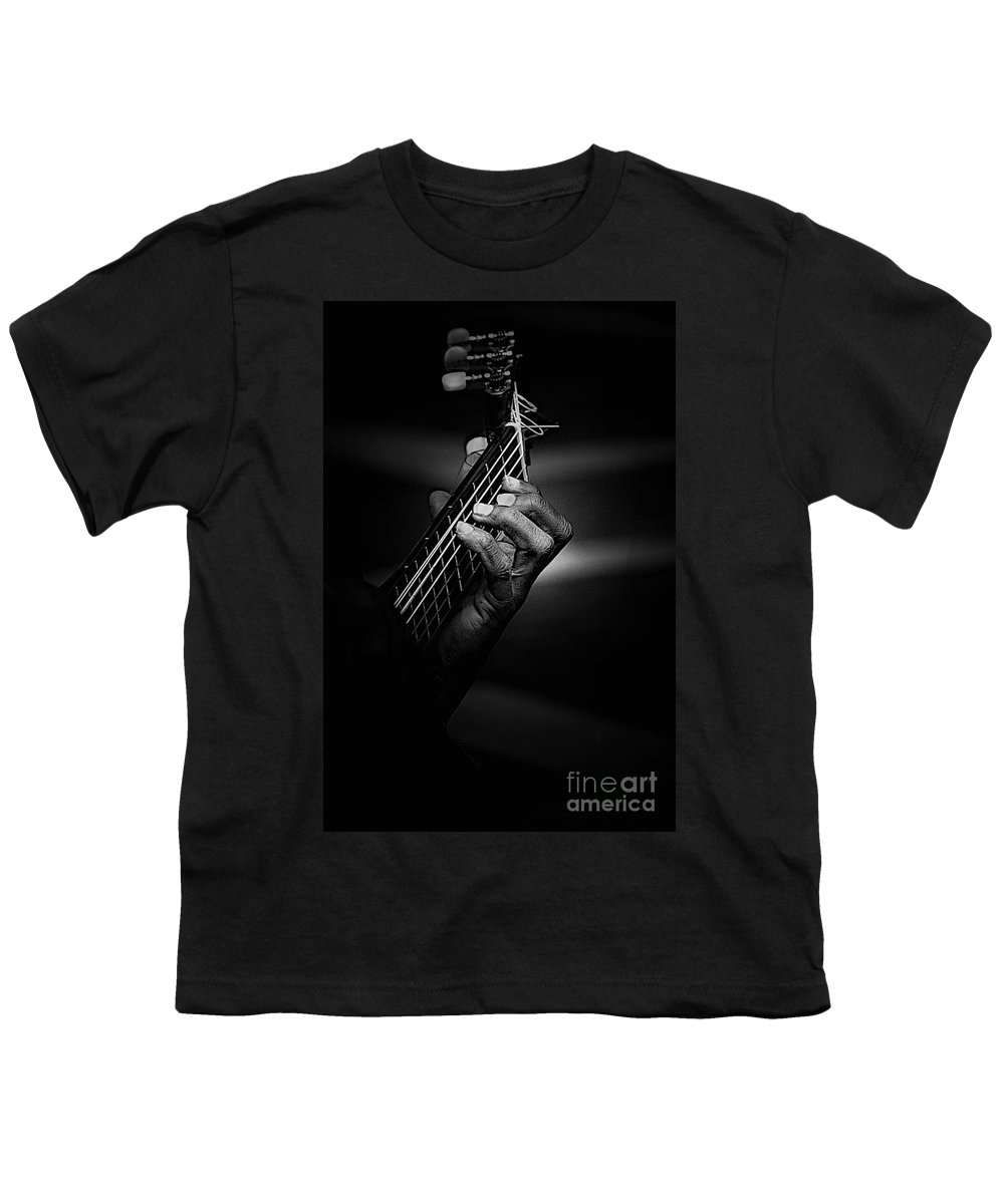 Guitar Youth T-Shirt featuring the photograph Hand Of A Guitarist In Monochrome by Avalon Fine Art Photography
