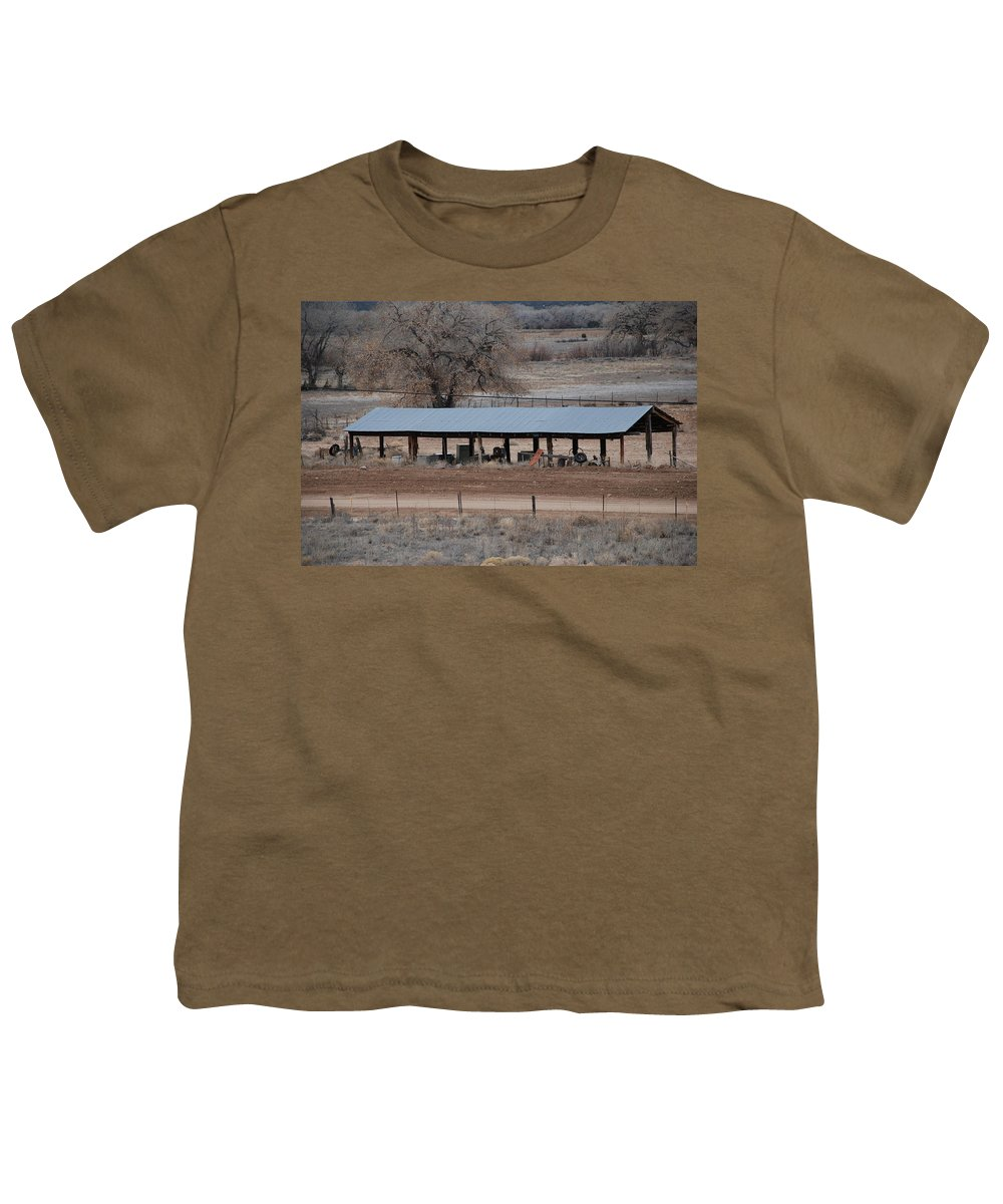 Architecture Youth T-Shirt featuring the photograph Tractor Port On The Ranch by Rob Hans