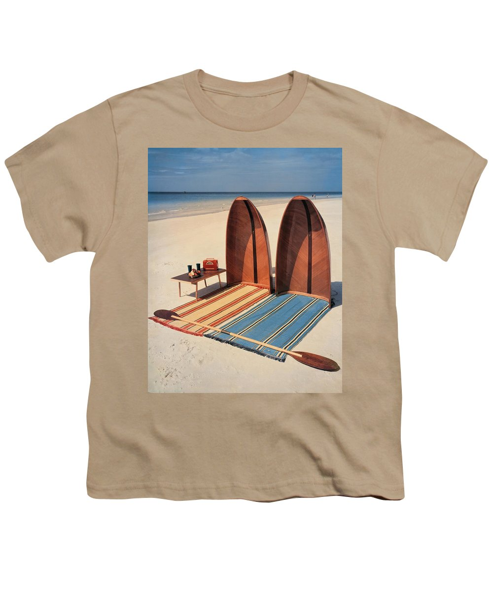 Accessories Youth T-Shirt featuring the photograph Pixie Collapsible Boat On The Beach by Lois and Joe Steinmetz