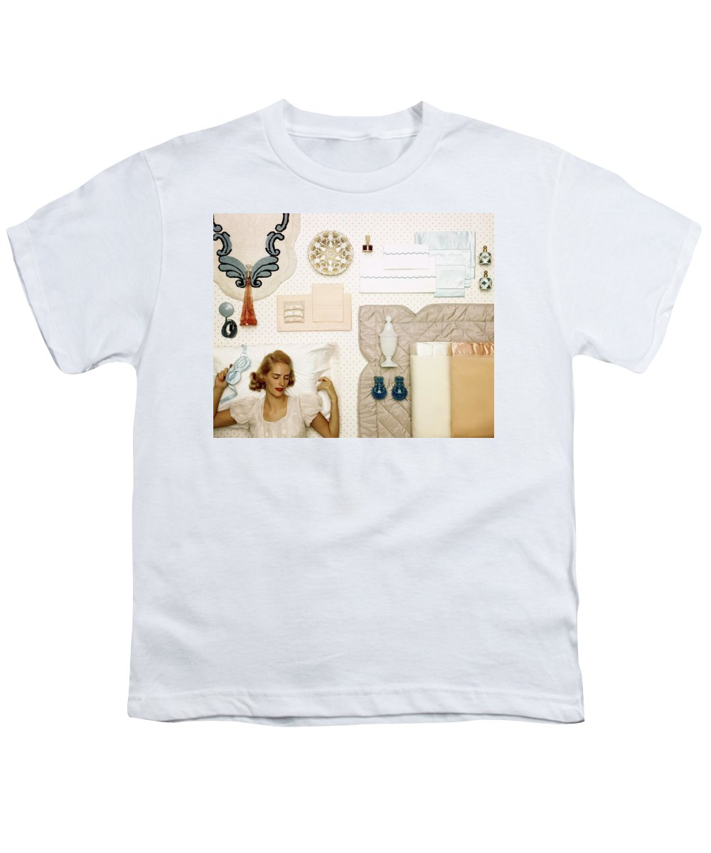 Bedroom Youth T-Shirt featuring the photograph A Woman Sleeping Next To An Assorted Range by Geoffrey Baker