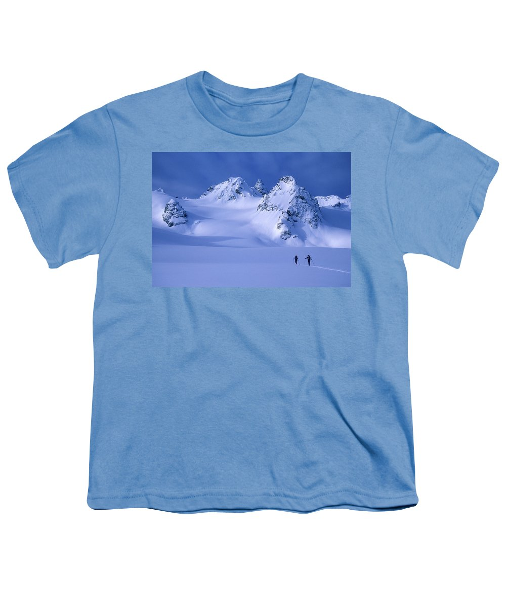 Adventure Youth T-Shirt featuring the photograph Two Skiers Ski Tour And Explore by Jimmy Chin