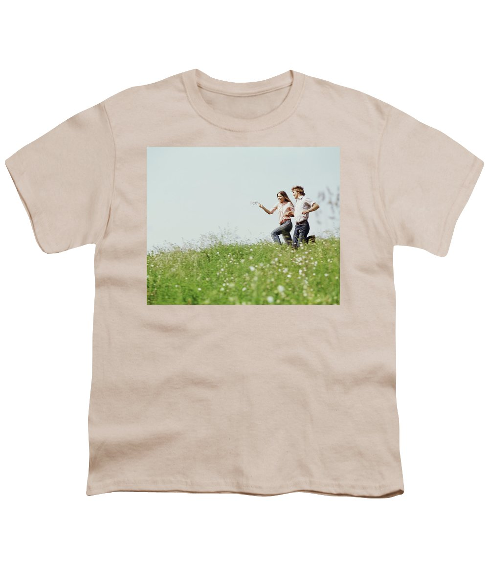 Photography Youth T-Shirt featuring the photograph 1970s Boy Girl Running Field by Vintage Images