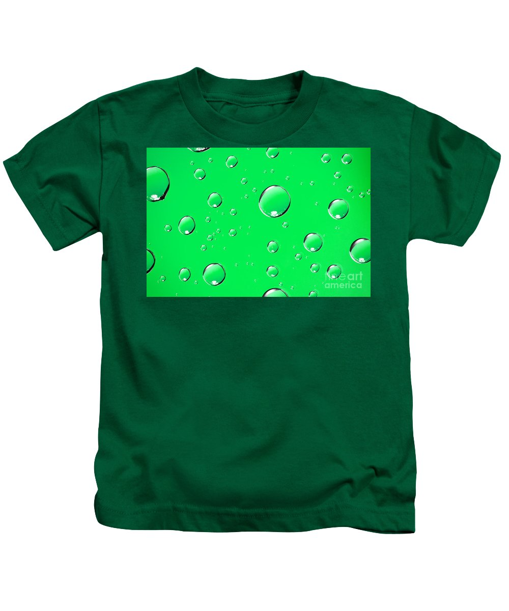 Water Kids T-Shirt featuring the photograph Water Drops On Green by Sharon Dominick