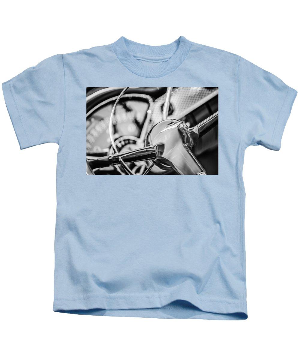 1955 Chevrolet Bel Air Convertible Steering Wheel Emblem Kids T-Shirt featuring the photograph 1955 Chevrolet Bel Air Convertible Steering Wheel Emblem -0976bw by Jill Reger