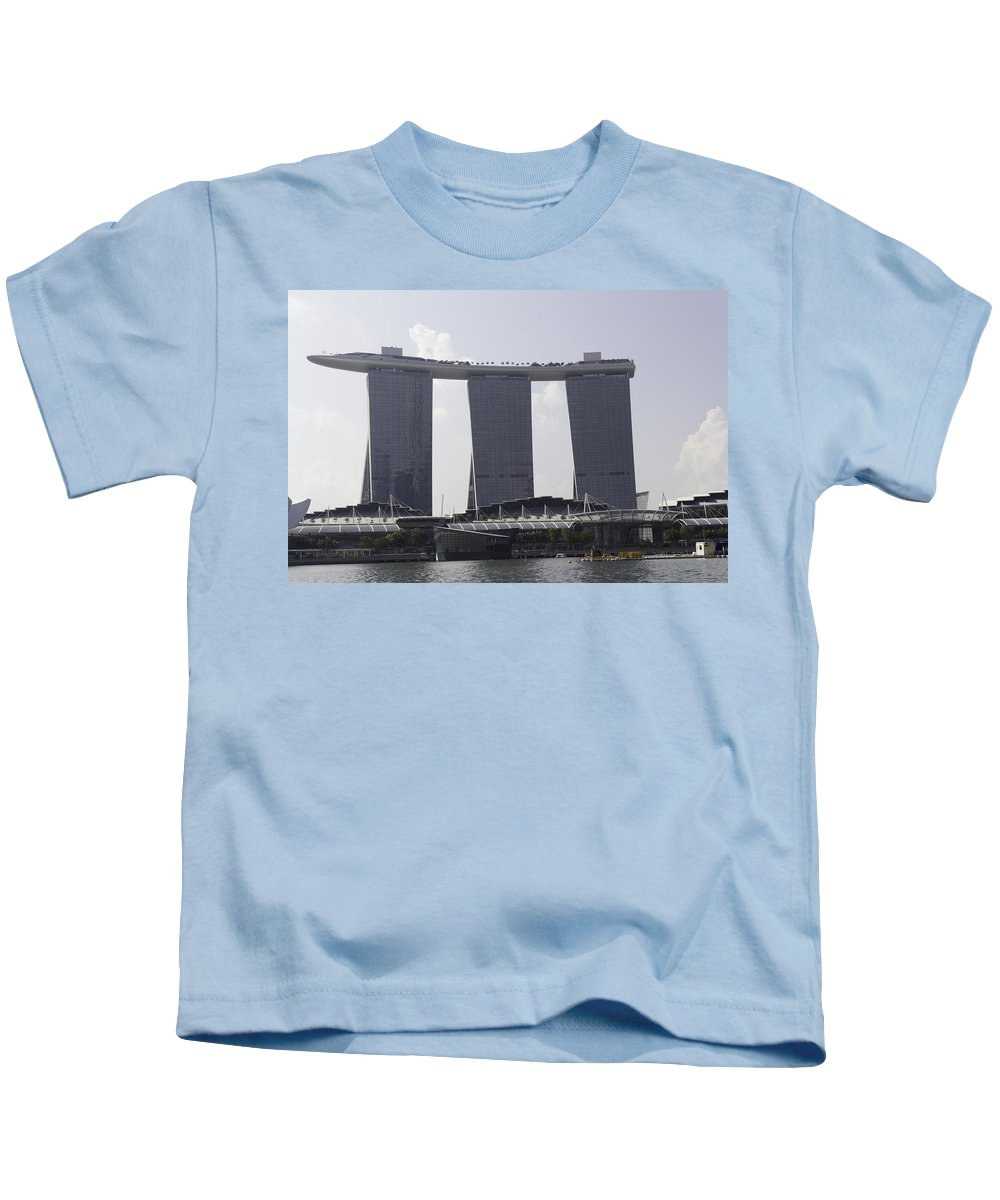3 Towers Kids T-Shirt featuring the photograph The Towers Of The Iconic Marina Bay Sands In Singapore by Ashish Agarwal
