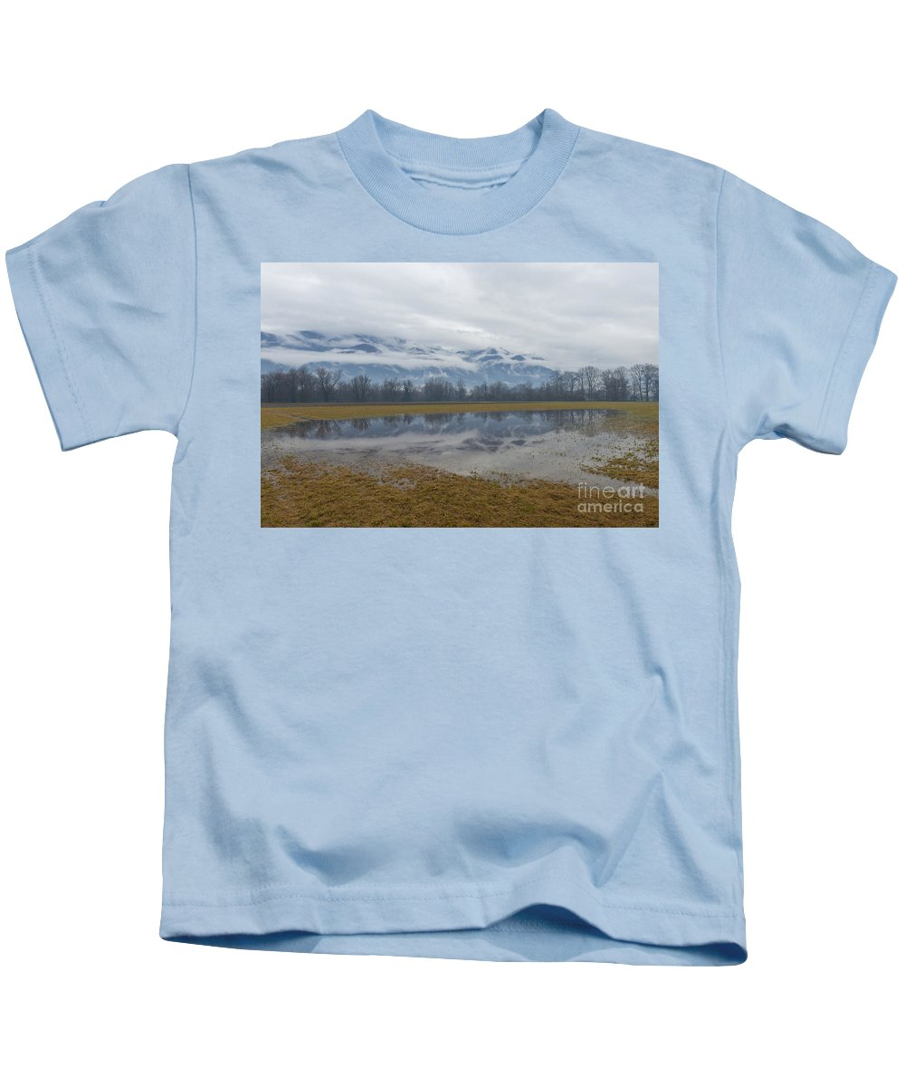 Field Kids T-Shirt featuring the photograph Water Puddle by Mats Silvan