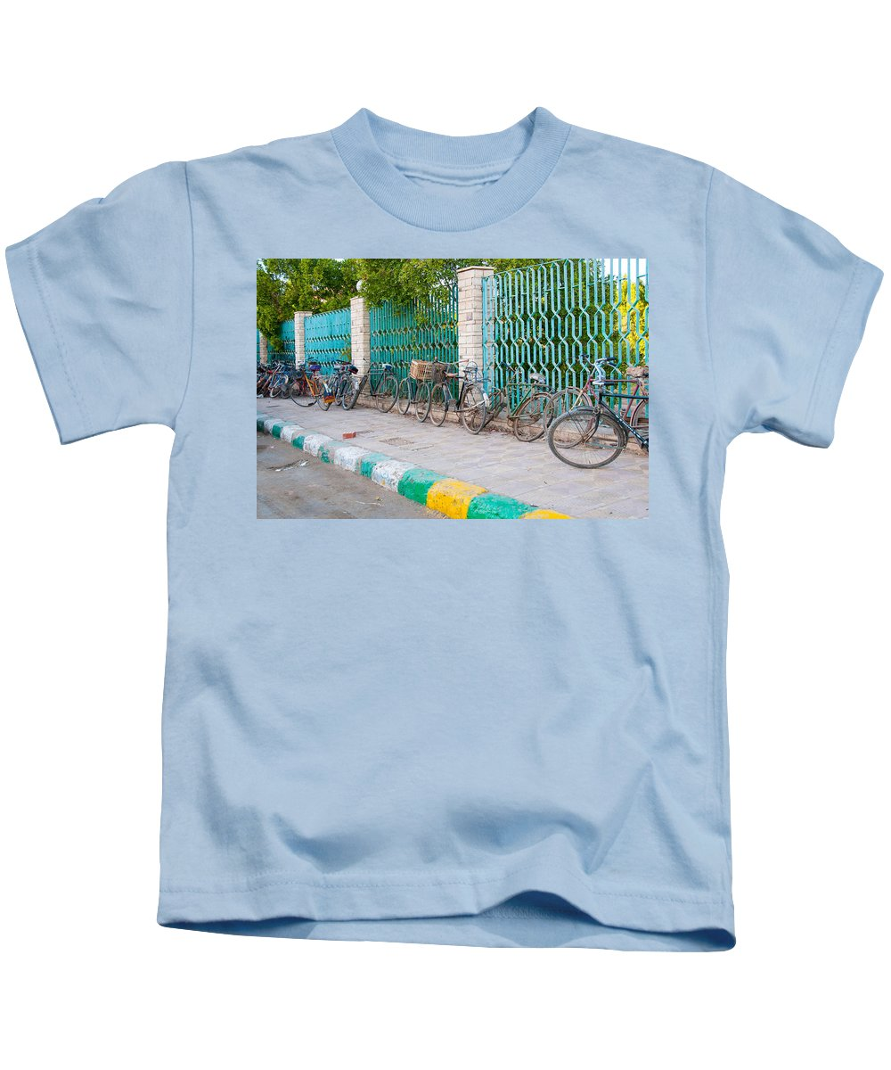 Bicycles Transportation Kids T-Shirt featuring the digital art Dakhla by Carol Ailles