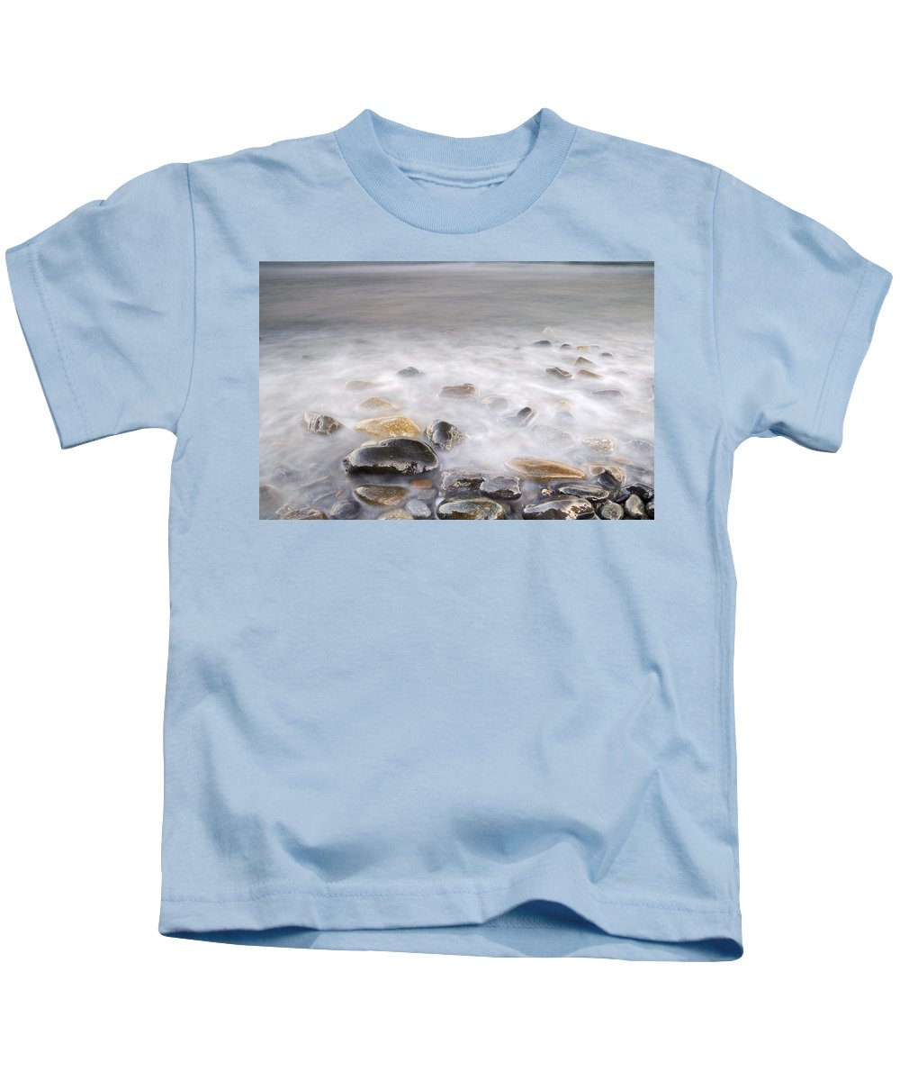 Seascape Kids T-Shirt featuring the photograph Brigtness At Sunset by Guido Montanes Castillo