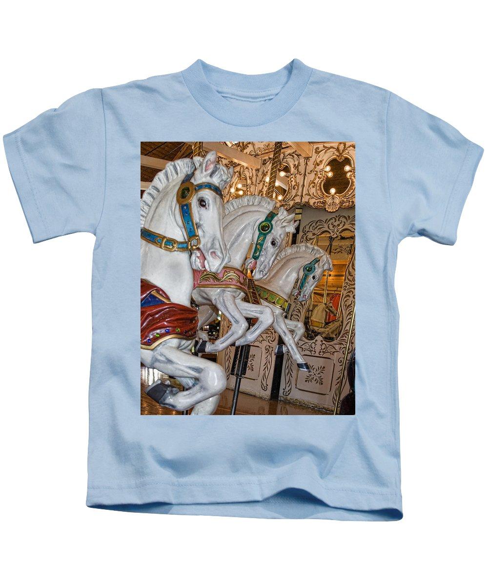 Carousel Kids T-Shirt featuring the photograph Caruosel Horses by Paul DeRocker