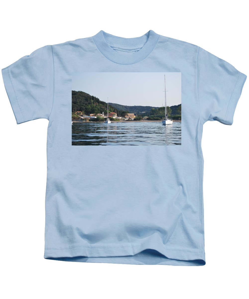 Agia Triada Kids T-Shirt featuring the photograph Erikousa Shines by George Katechis