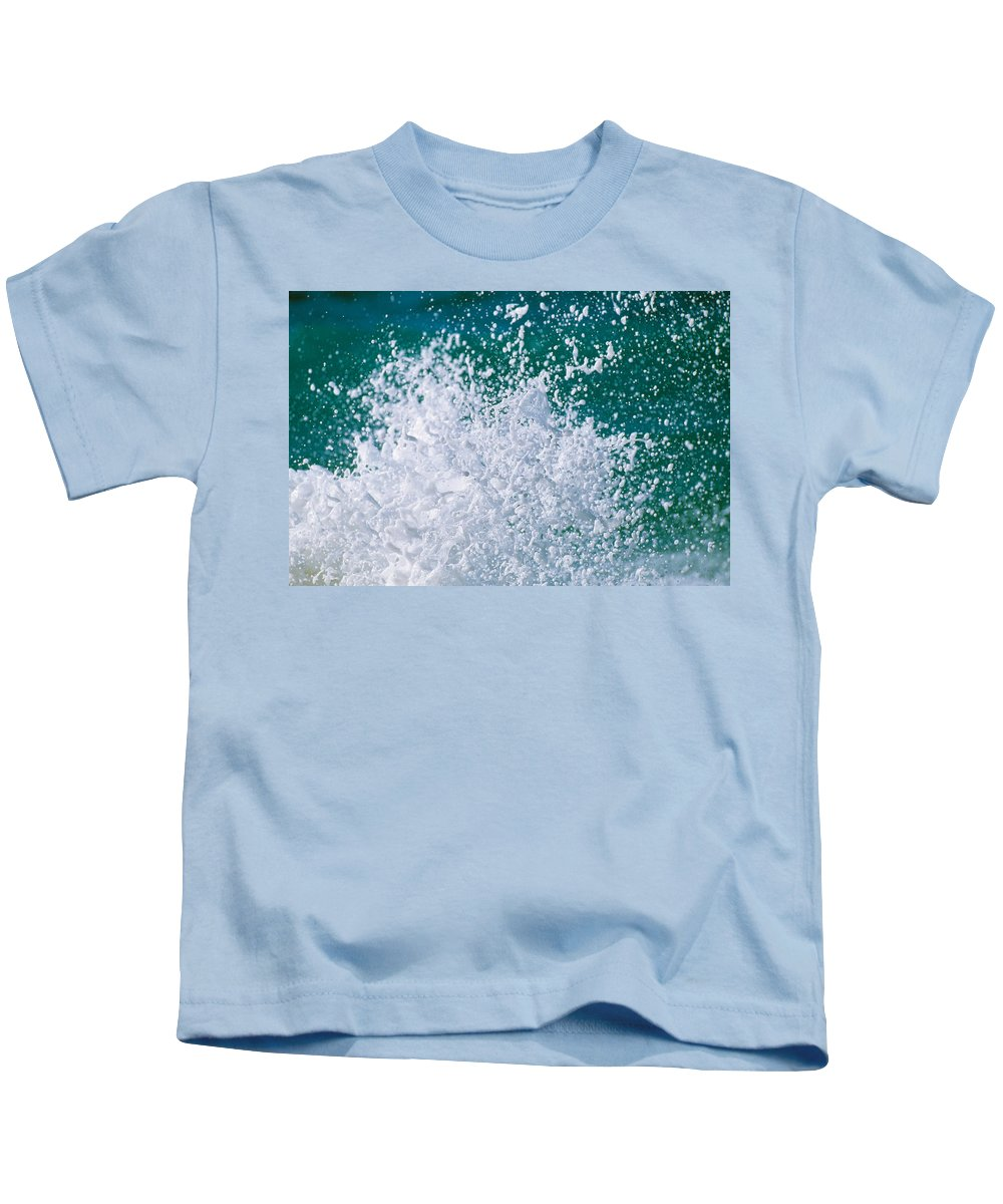 Photography Kids T-Shirt featuring the photograph Foam Splashing In The Sea by Panoramic Images
