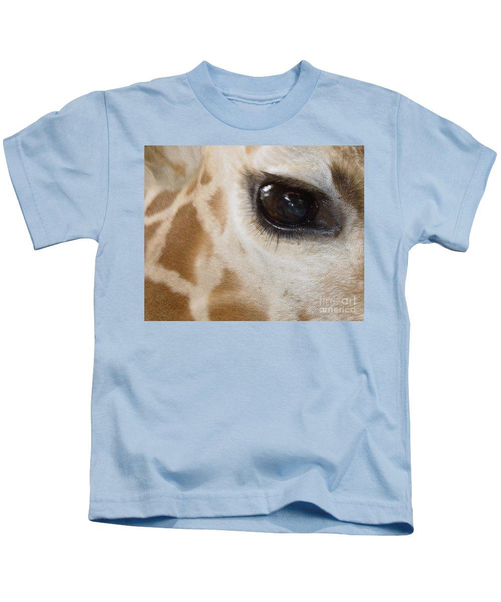 Giraffe Kids T-Shirt featuring the photograph Giraffe Eye by Heather Coen