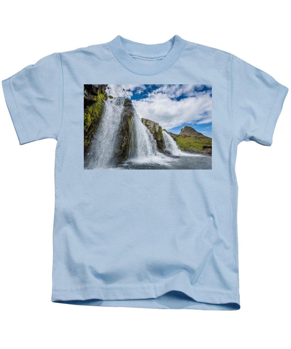 Photography Kids T-Shirt featuring the photograph Kirkjufellsfoss Waterfalls, Church by Panoramic Images