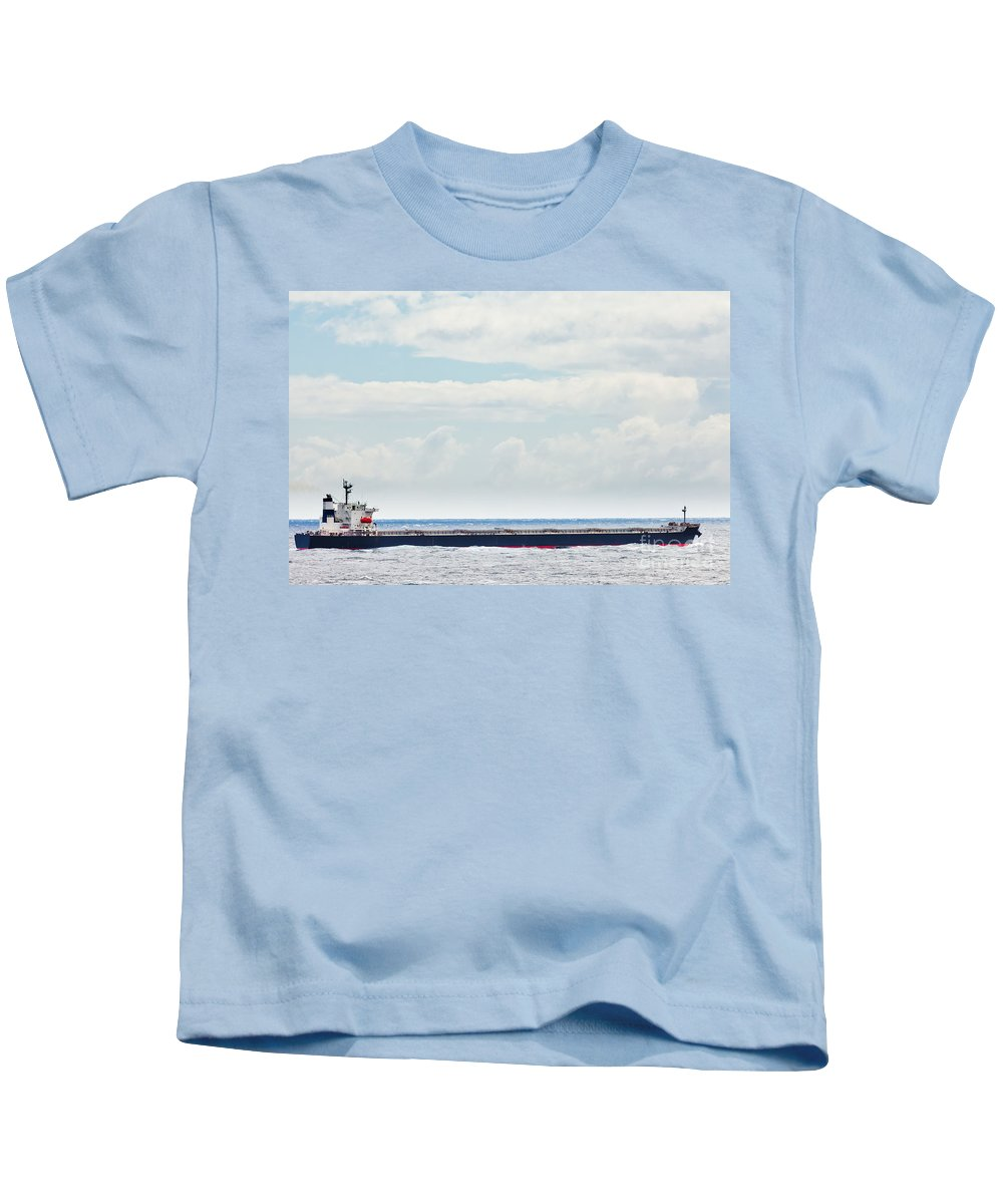 Big Kids T-Shirt featuring the photograph Loaded Oil Tanker On Ocean Under Stormy Sky Clouds by Stephan Pietzko