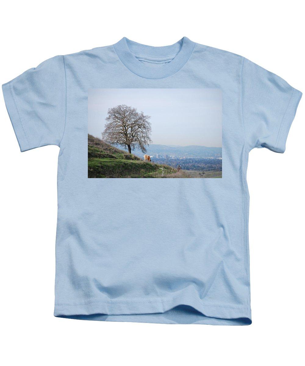 Moo Kids T-Shirt featuring the photograph Moo Cow Grazing by Bradley Bennett