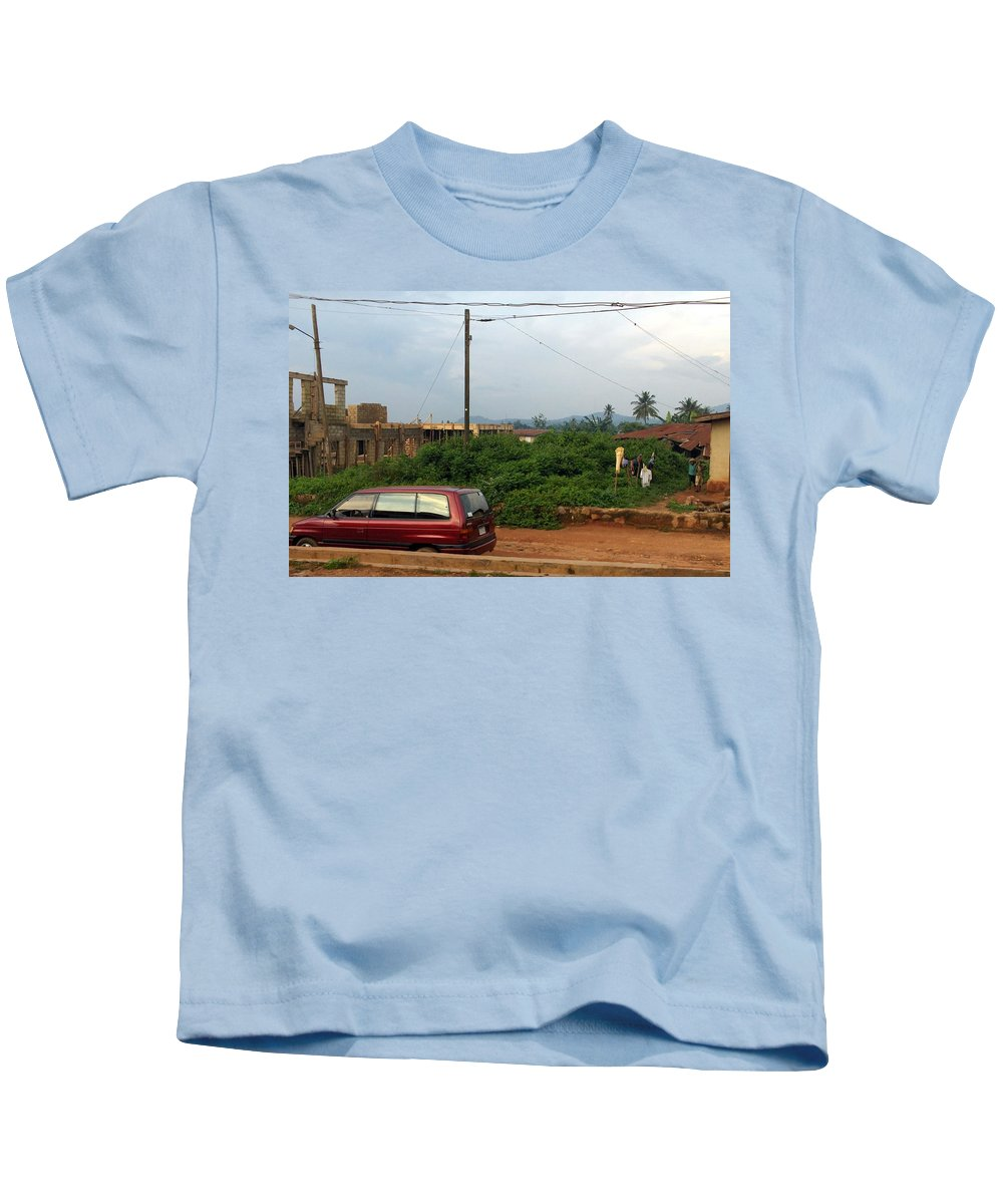 Mountains Kids T-Shirt featuring the photograph Nigerian Mountains In The Distance by Amy Hosp