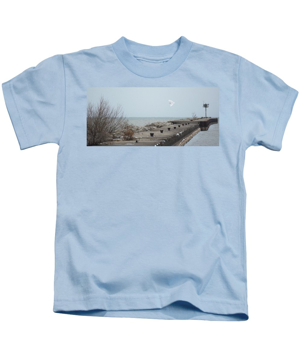 Snowy Owl Kids T-Shirt featuring the photograph Snowy Owl On The Move by Tracy Winter