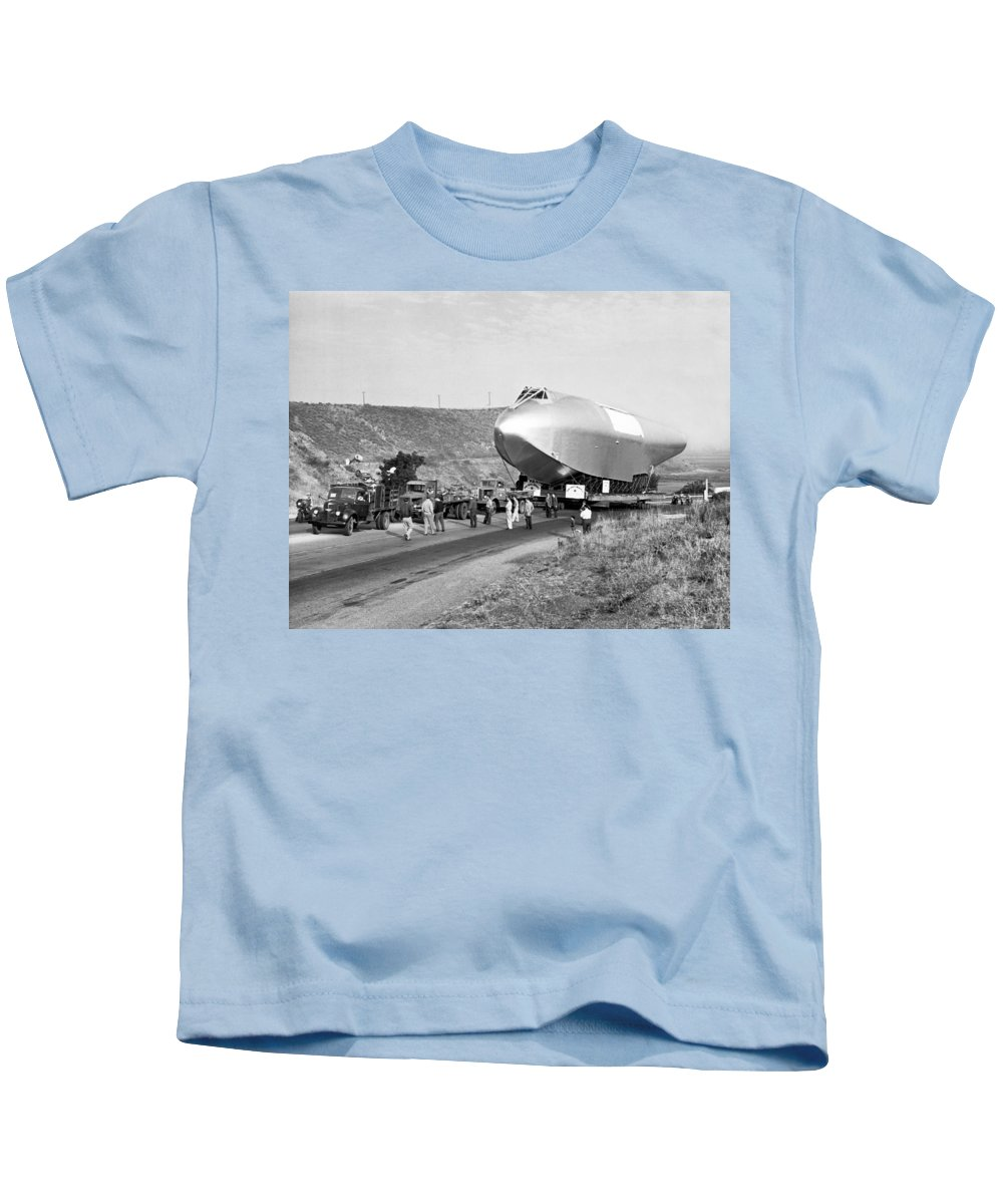 1940's Kids T-Shirt featuring the photograph Spruce Goose Hull On The Move by Underwood Archives