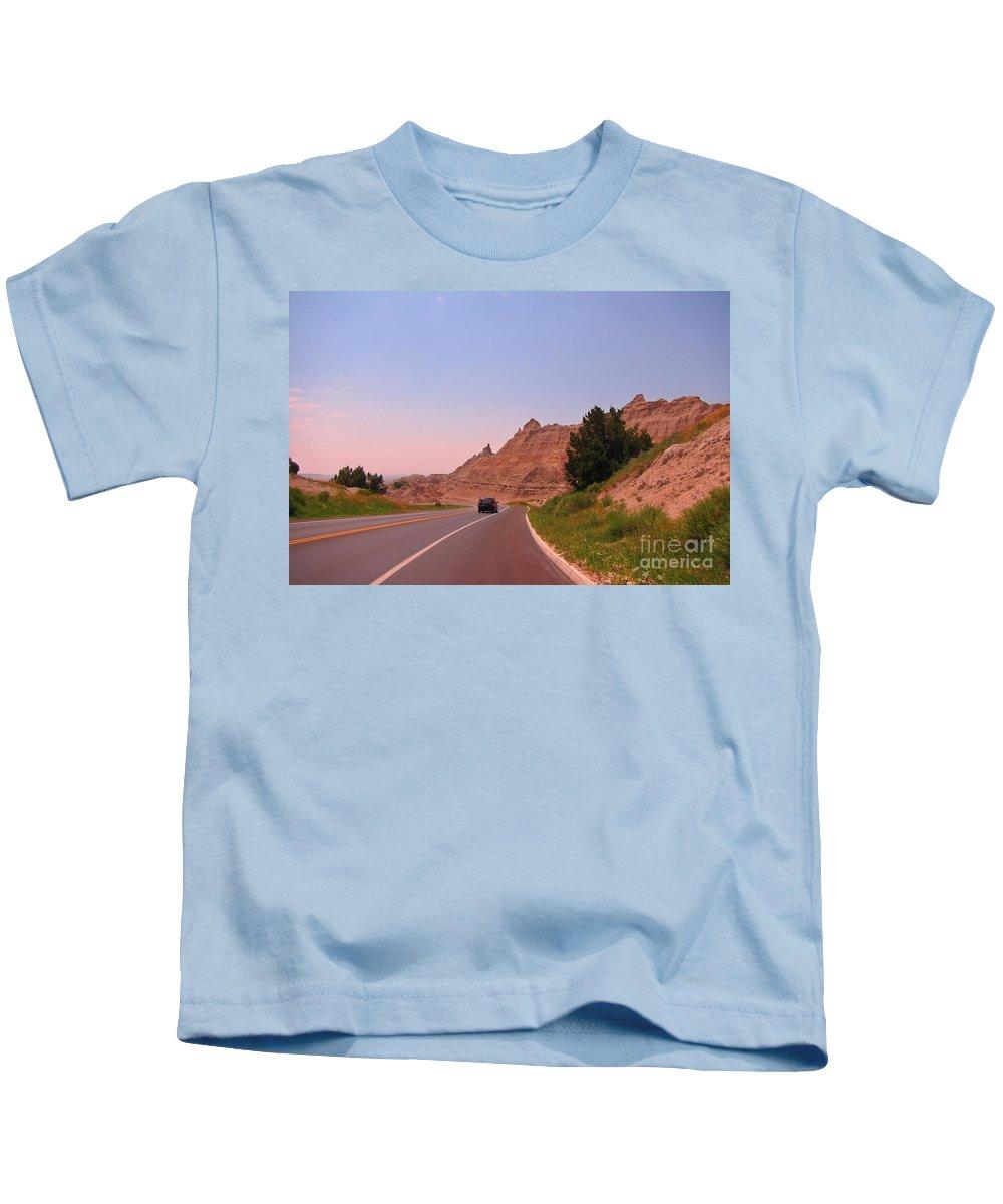 Through The Badlands Of South Dakota Kids T-Shirt featuring the photograph Through The Badlands Of South Dakota by John Malone
