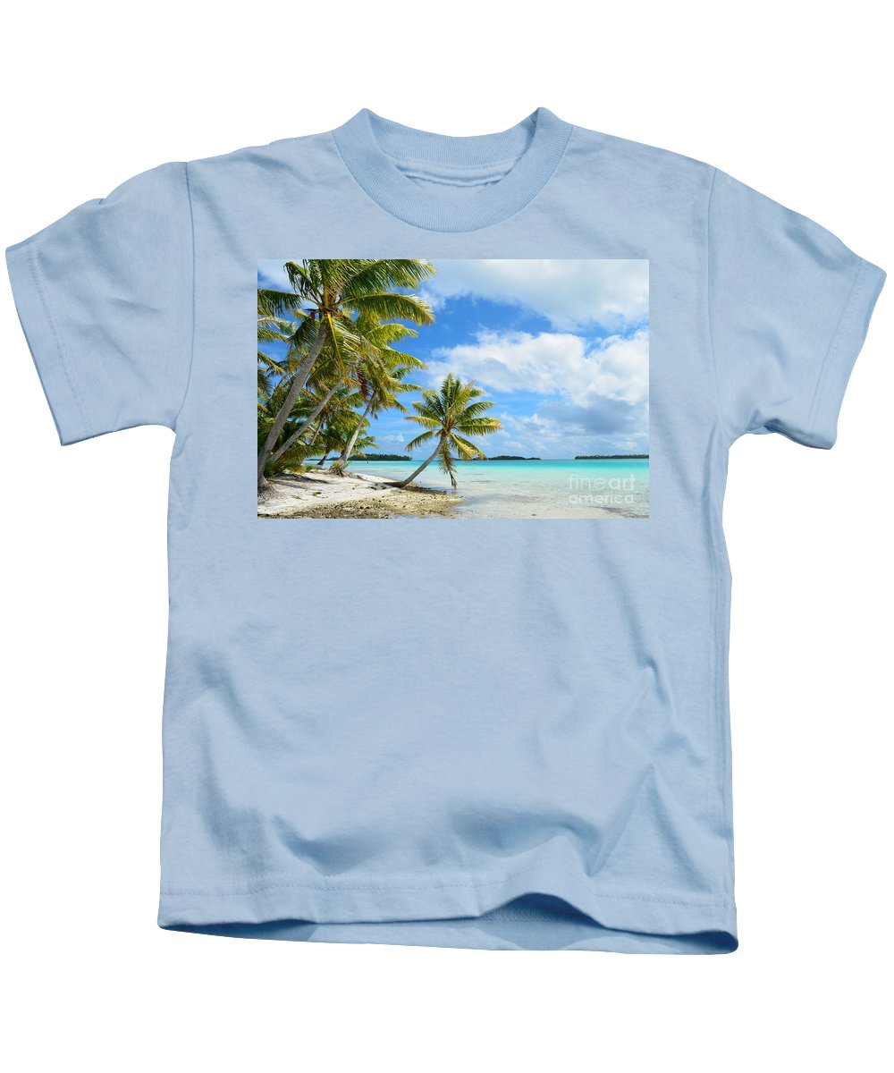 Beach Kids T-Shirt featuring the photograph Tropical Beach With Hanging Palm Trees In The Pacific by IPics Photography