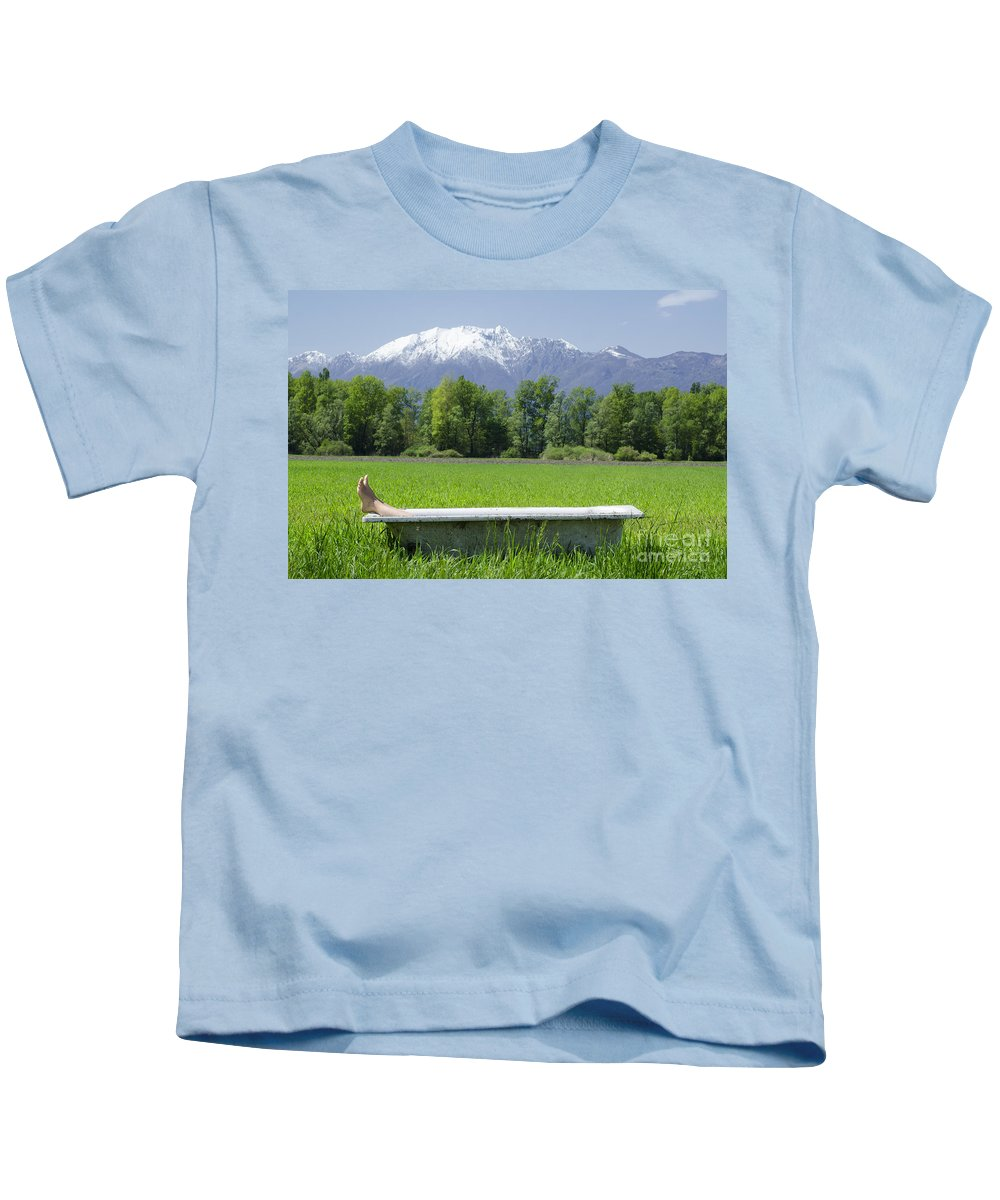 Feets Kids T-Shirt featuring the photograph Bathtub On A Green Field by Mats Silvan
