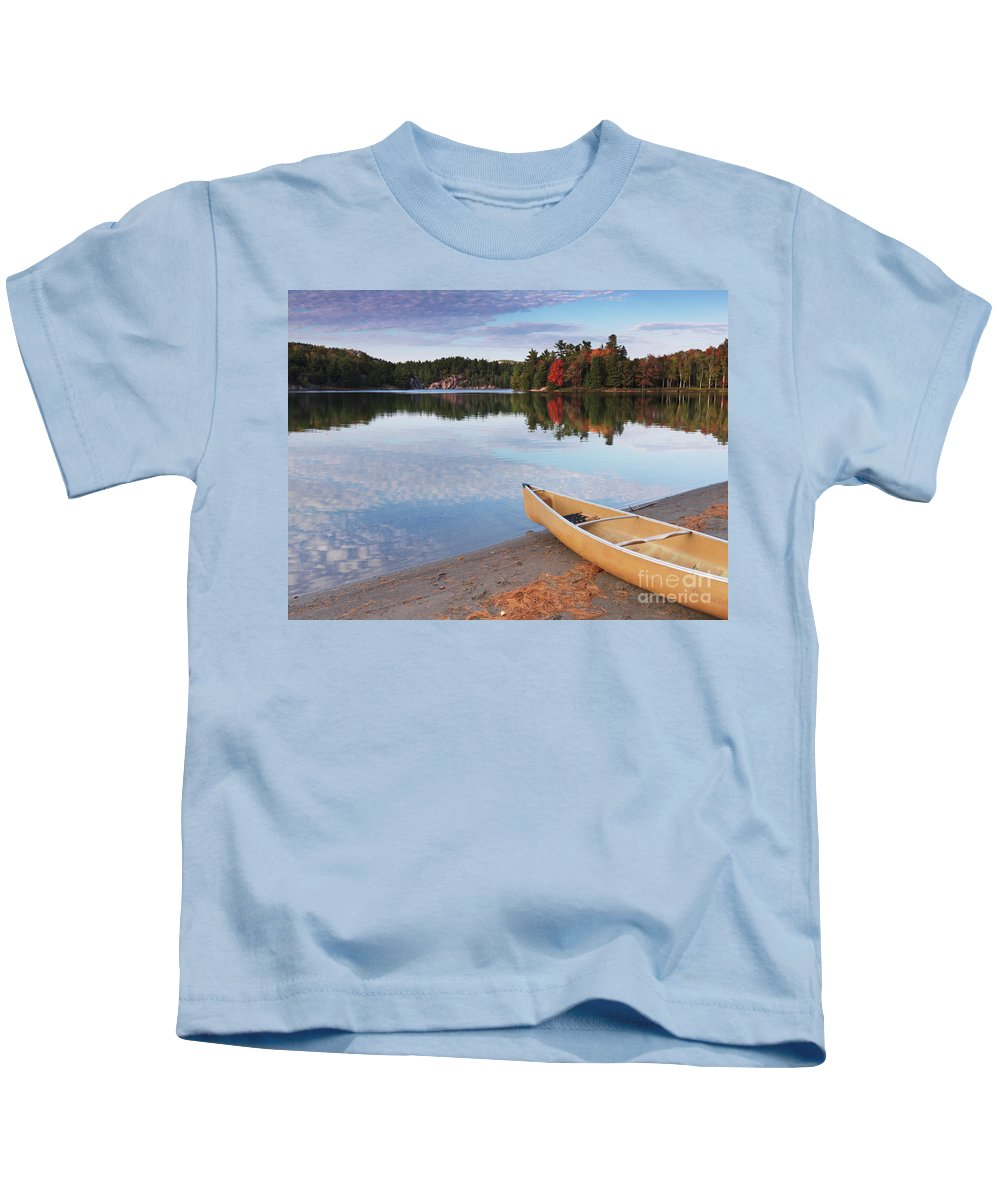 Canoe Kids T-Shirt featuring the photograph Canoe On A Shore Autumn Nature Scenery by Oleksiy Maksymenko